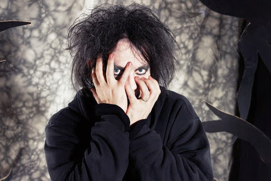 The Cure's Robert Smith hiding his face